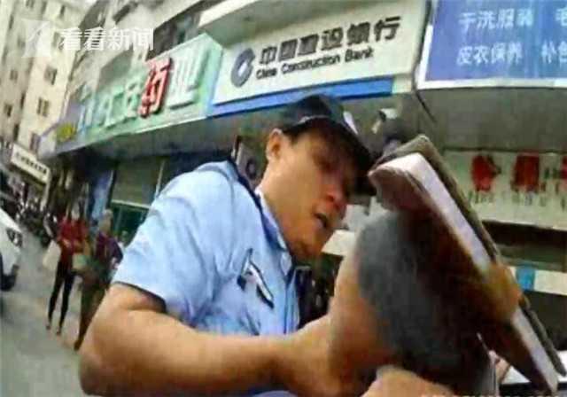 暴力阻挠治安监控安装 中年女子对民警又打又咬  监控新闻  第3张